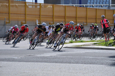 The author leads the bunch into the final corner of a Melbourne criterium race.
