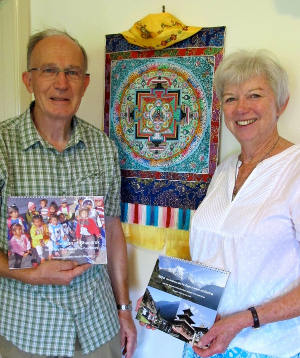Northern Rivers residents John and Helen Niven with calendars of Nepal that they produce to support their volunteer dental work in the Himalayan country.
