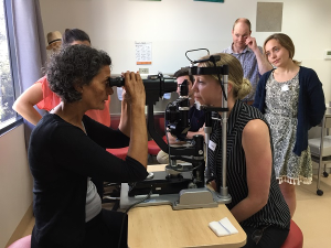 Dr Anne Malatt - Eye Surgeon demonstrating the use of a slit lamp