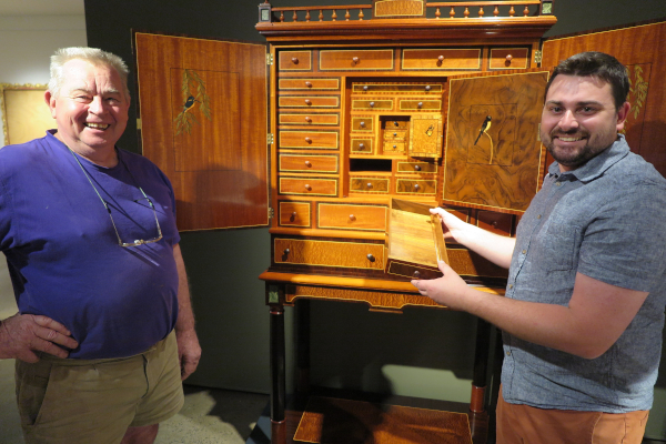 Master cabinet maker Geoff Hannah with former student Colin Fardon and the latter's creation, Three Little Birds, sold for $68,000.