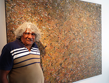 Bundjalung artist Digby Moran with Lismore Flood, one of the highlights of his recent 'Growing up on the Island' exhibition at Lismore Regional Gallery.