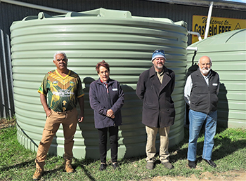 Jubullum Aboriginal community member Daniel Walker, Vinnies St Therese Casino Conference president Marlene Landrigan, The Shed of Hope's Greg Dollin and Vinnies Richmond Regional president Michael Albany with the donated water tank.